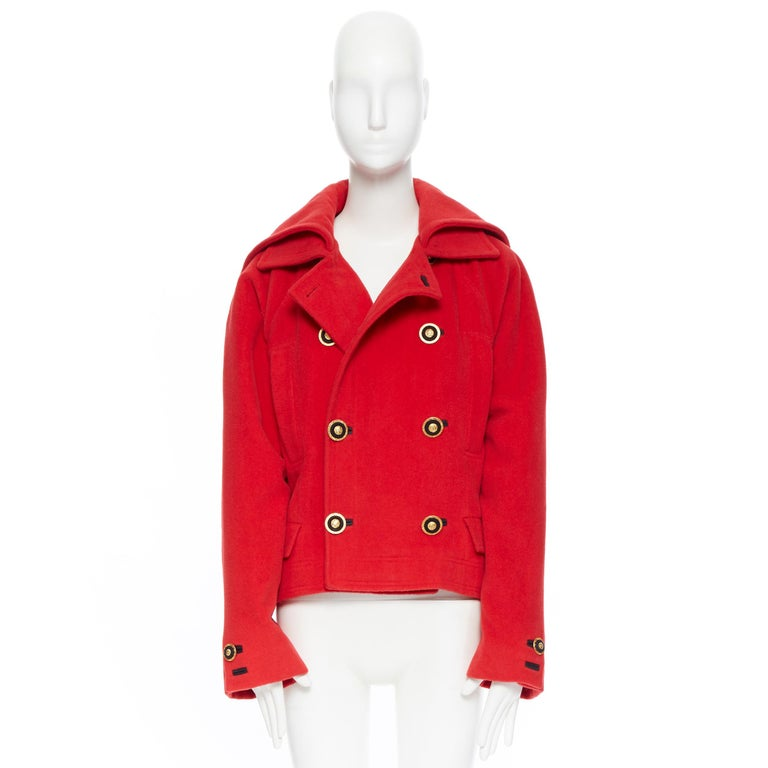 GIANNI VERSACE 1993 Vintage red wool Medusa button double breasted coat M Brand: Versace Designer: Gianni Versace Model Name / Style: Wool coat Material: Wool Color: Red Pattern: Solid Closure: Button Extra Detail: Dual layered spread collar.
