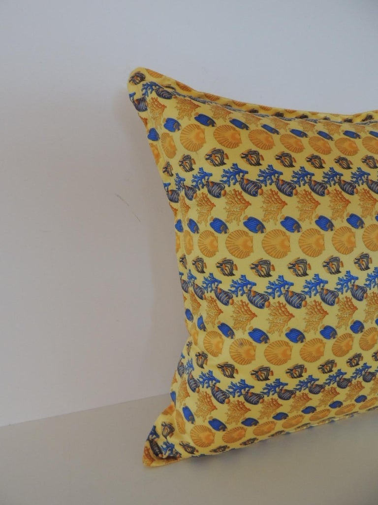 Gianni Versace authentic seashells and coral printed decorative pillow. Original label inside. Backed with Barocco yellow cotton fabric. In shades of yellow, blue and gold. This pillow was designed by Versace before he died in the 1990s Zipper