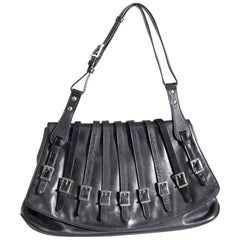 Gianni Versace bag black bondage line in embossed leather and metal, 90s