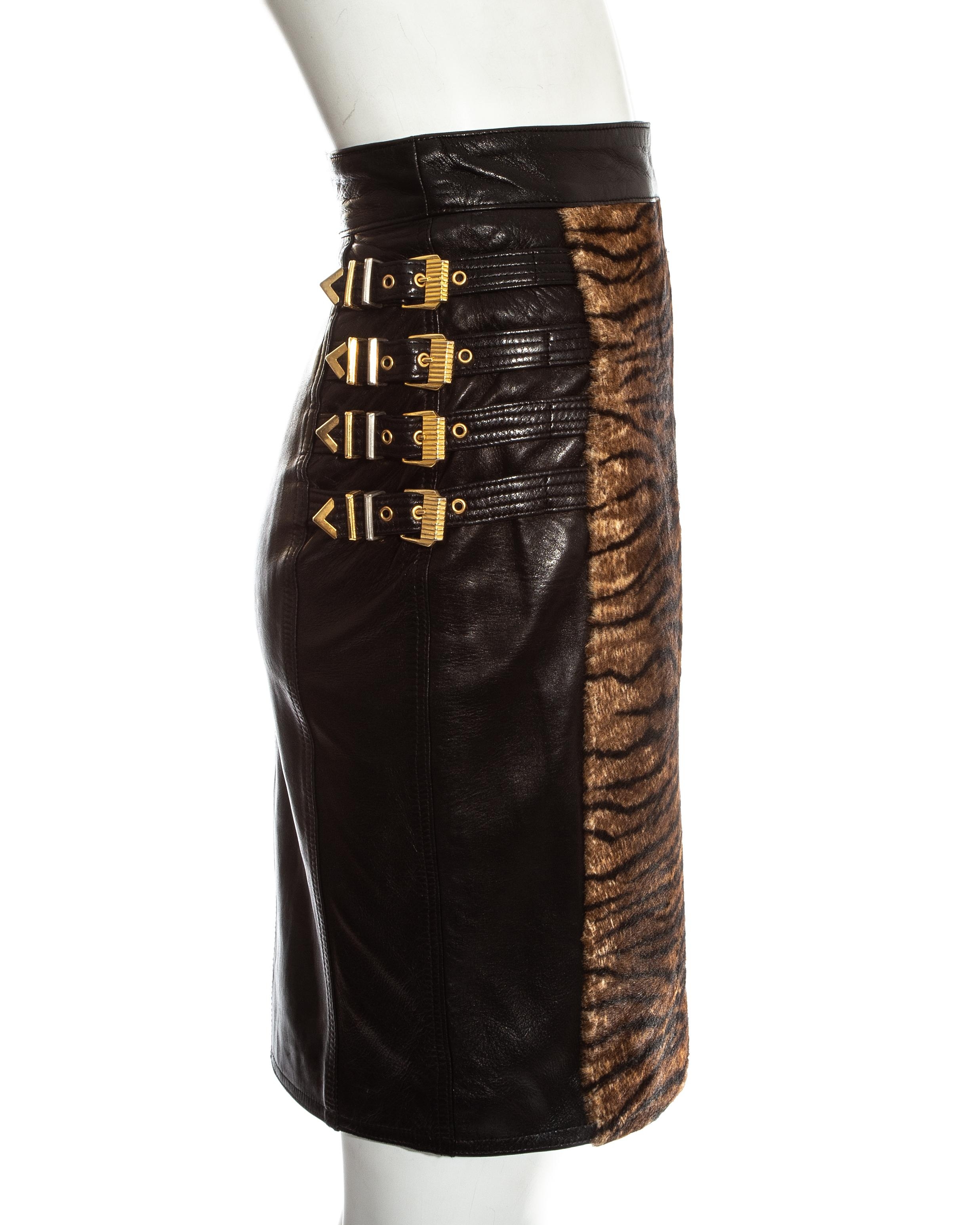 5bf4a1bdff Gianni Versace black leather gold buckled skirt with animal print, fw 1994