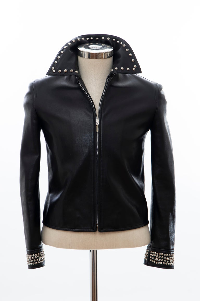 "Gianni Versace, circa 1990's, black leather jacket with pewter stud embellishments at collar and cuffs, dual straps at back hem, front zip closure and fully lined.  IT. 40 US. 4  Bust 35"", Waist 32"", Shoulder 16"", Length 20.5"", Sleeve 22.5"" Fabric"