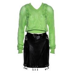 Gianni Versace black leather safety pin skirt and sweater ensemble, ss 1994