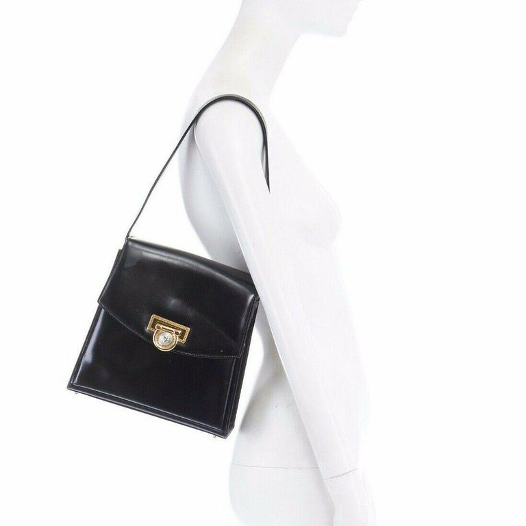 GIANNI VERSACE black smooth leather gold silver Medusa buckle chain trim box bag  GIANNI VERSACE Black smooth calf leather . Structured bag . Tonal stitching . Greek embossed hardware at front . Looped through gold and silver Medusa head buckle