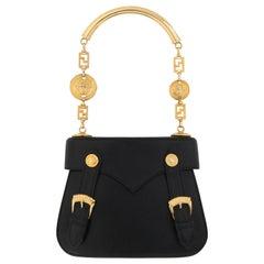 GIANNI VERSACE c.1990's Black Leather Gold Medusa Mini Buckle Handbag Purse