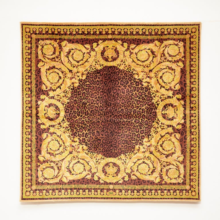 Rug designed and manufactured by Atelier Versace  Wild Barocco  Measures: 220 x 220   In good original condition, with minor wear consistent with age and use  A vintage Gianni Versace home signature wool rug. Baroque gold tones, leopard