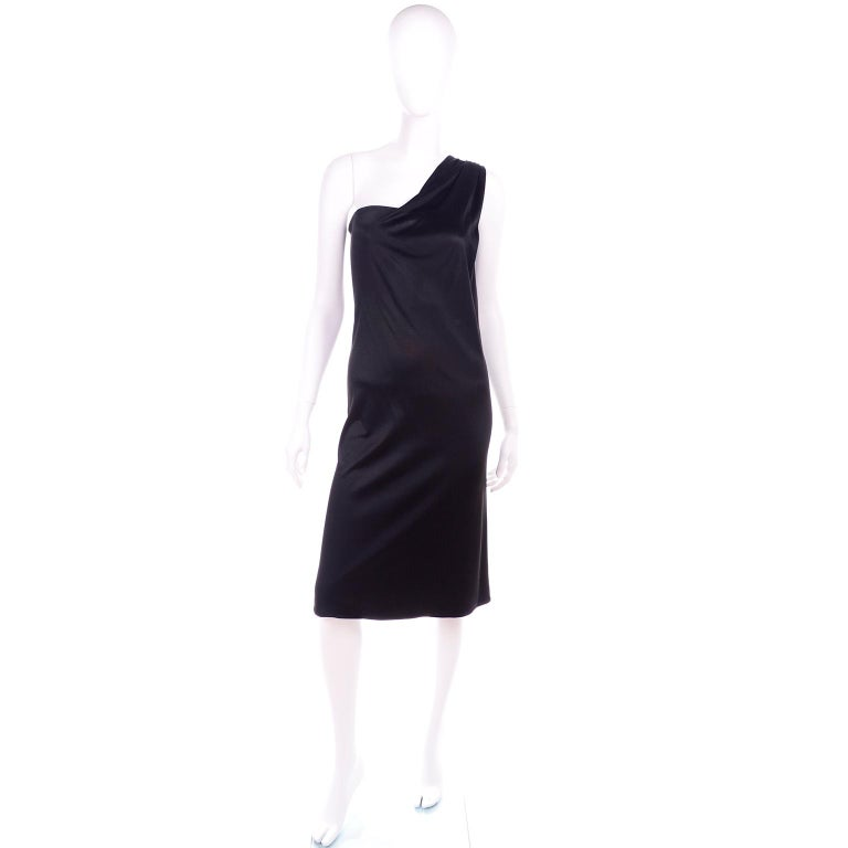 This is a fabulous little black dress from Versace's 1998 collection. This one shoulder 90's dress has a metal side zipper and a wire bustier insert. We love the leather and metal buckle in the back with the small medusa head. The dress is in a
