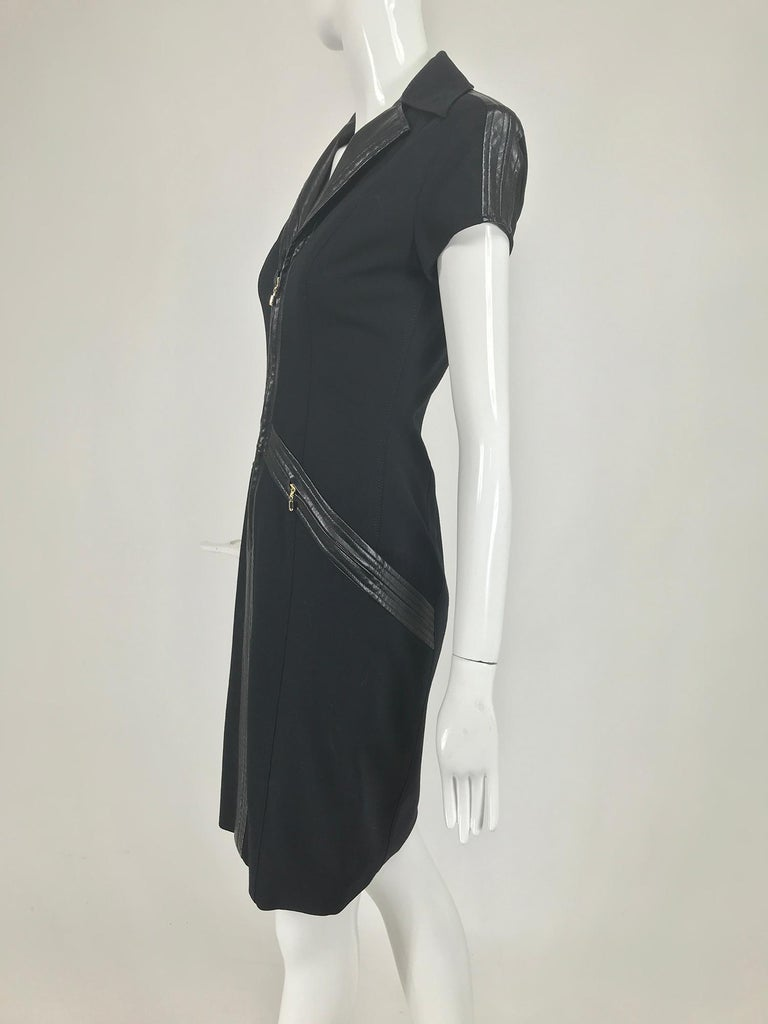 Gianni Versace Couture black stretch fabric with black vinyl sleeves and trims with gold metal zippers from the 1980s. Fitted dress with notched wing collar, the lapels are black vinyl, short cap sleeves have a top stitched vinyl strip up the
