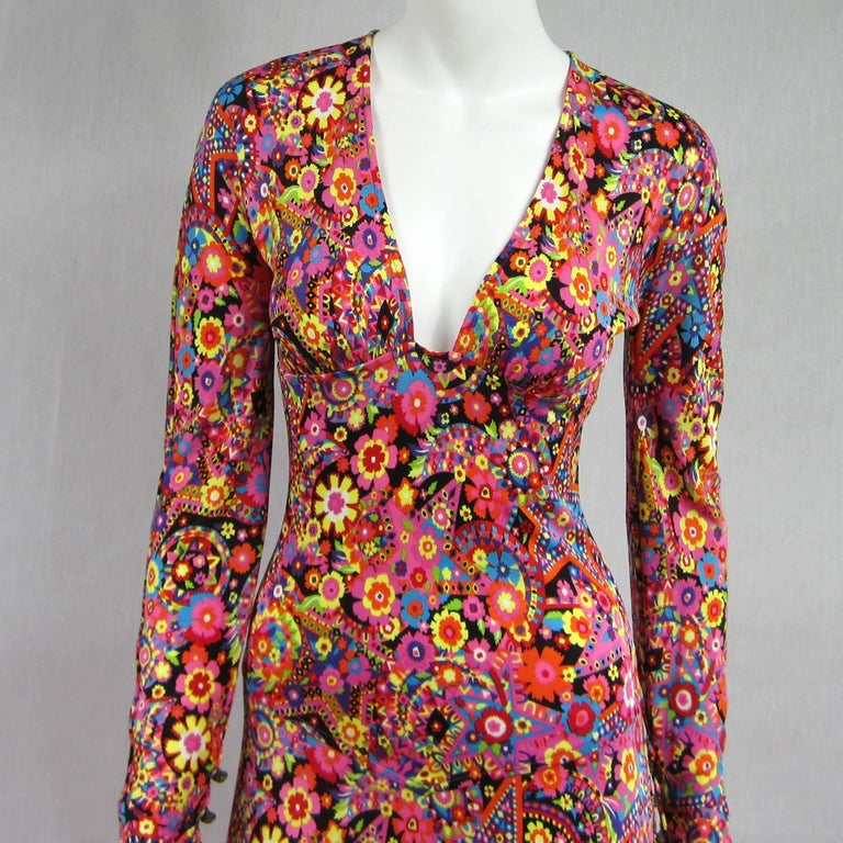 Details, Details on this Fabulous Gianni Versace Dress. Each side features a slit with Brass buttons, some are faux and others are usable. The sleeves as well have the same detailing. Very Sexy Plunging neckline on this dress. Zippered back. Labeled