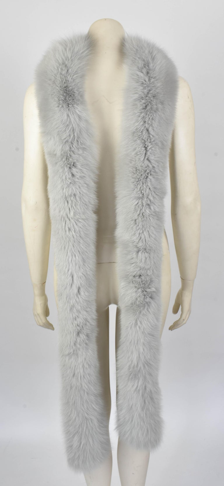 This scarf by Gianni Versace Couture is very fluffy and soft as it is made from real fox fur. It is extremely long so it can be worn in different manners. A similar scarf was shown in the Atelier Versace show in 2014.  Perfect condition