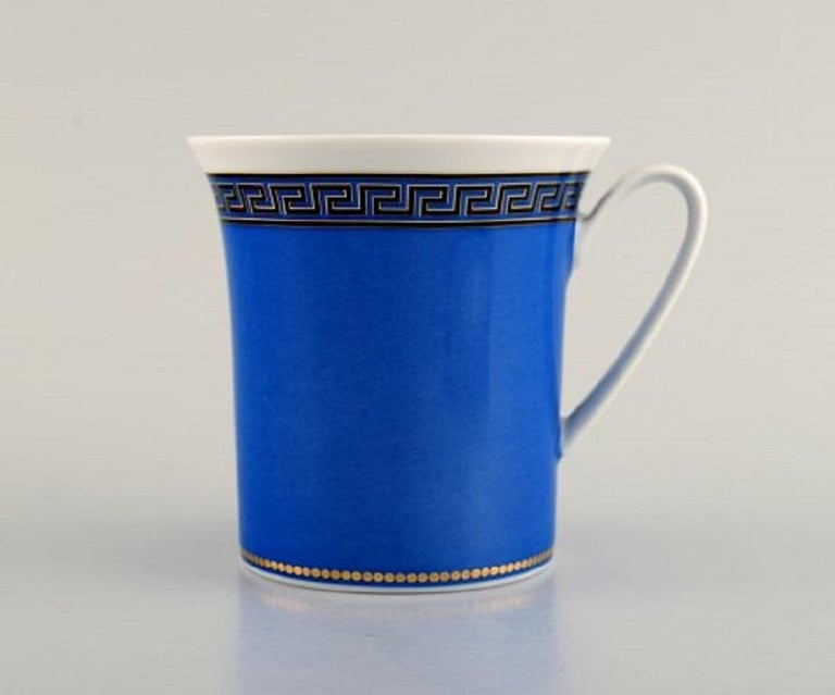 Gianni Versace for Rosenthal. Le Roi Soleil coffee cup with saucer in porcelain, late 20th century. In perfect condition. The cup measures: 9.5 x 9.5 cm. Saucer diameter: 17.5 cm. Stamped.