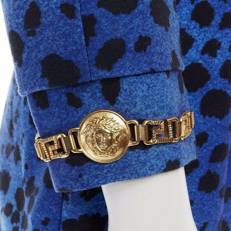 GIANNI VERSACE gold baroque print blue leopard Medusa button jacket skirt set XS  GIANNI VERSACE VINTAGE WOOL . GOLD BAROQUE PRINT . BLUE LEOPARD PRINT BASE . OVERSIZED MEDUSA HEAD GOLD MEDALLION BUTTON . COLLARLESS . BLACK TRIMMING ALONG FRONT