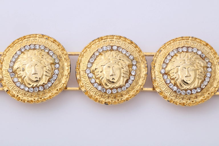 Women's or Men's Gianni Versace Gold Toned Bracelet With 6 Medusas and Rhinestones For Sale