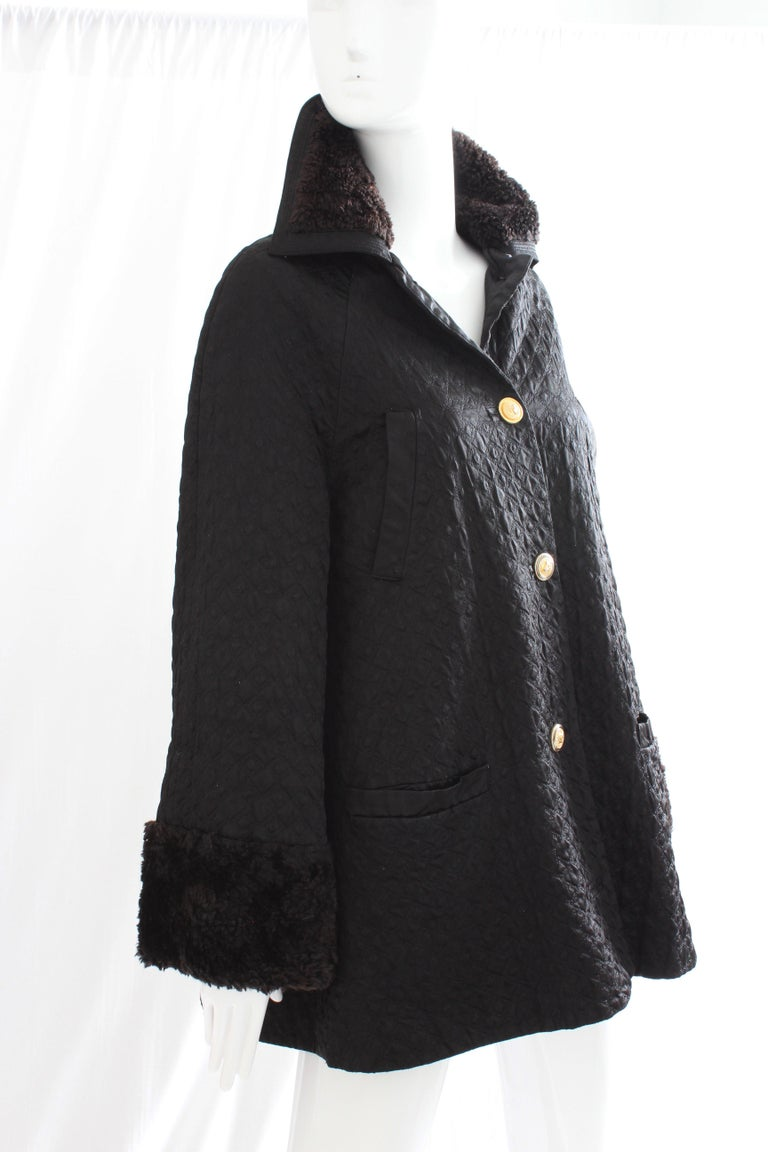 This black diamond-quilted satin jacket with fur trim was made by Gianni Versace for their Versus label, most likely in the 1990s.  No content label, but this piece appears to be made from a soft synthetic black satin and has deep brown faux fur