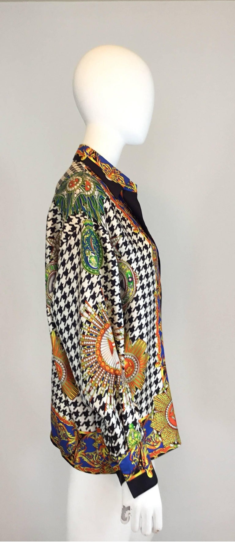 Vintage Versace blouse made of 100% silk features a vibrant and sharp print throughout with button closures along the front and on the cuffs. Bold graphic print. Boxy slouchy oversized fit. Miami era lifetime Versace. Made in Italy.  bust-