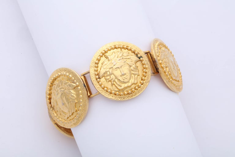 Gianni Versace Massive Gold Toned Bracelet With 5 Medusas In Good Condition For Sale In Chicago, IL