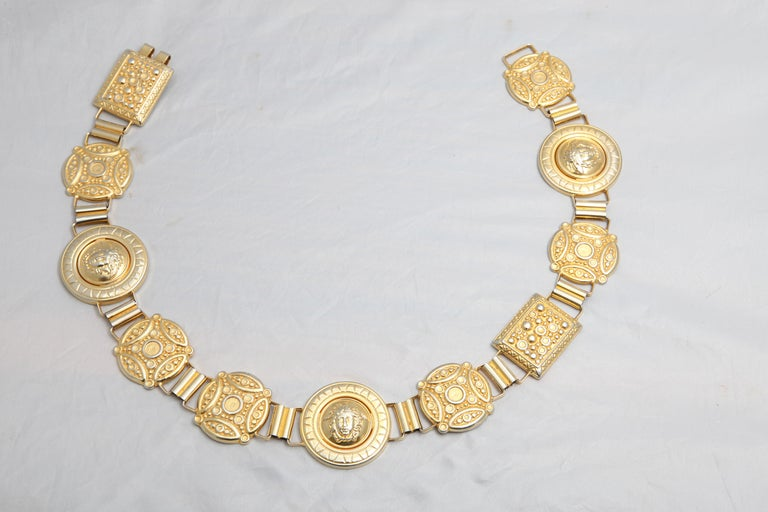 Gianni Versace massive belt with iconic Medusa motif.