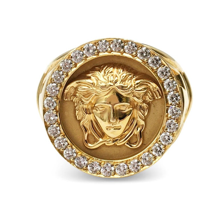 Authentic Gianni Versace ring crafted in 18 karat yellow gold centers on the iconic Medusa head which is surrounded by high-quality round brilliant cut diamonds weighing an estimated 0.80 carats total weight. Signed Gianni Versace, 18K 750. Ring