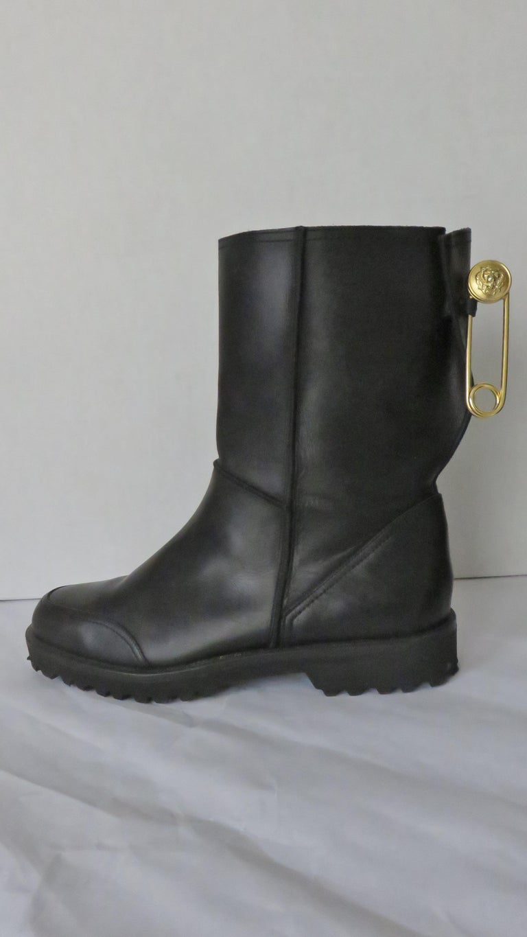 Fabulous black leather boots from Gianni Versace Versus Collection.  They are calf height with a lug sole and heel and a large gold 3.5