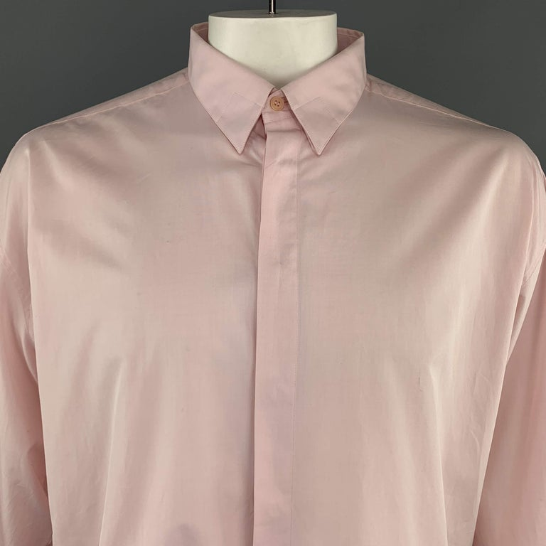 Vintage GIANNI VERSACE Long Sleeve Shirt comes a pink tone in a solid cotton material, with hidden buttons, buttoned cuffs, button down. Made in Italy.   Brand New. Marked: IT 54   Measurements: Shoulder: 22.5 in. Chest: 54 in. Sleeve: 23.5