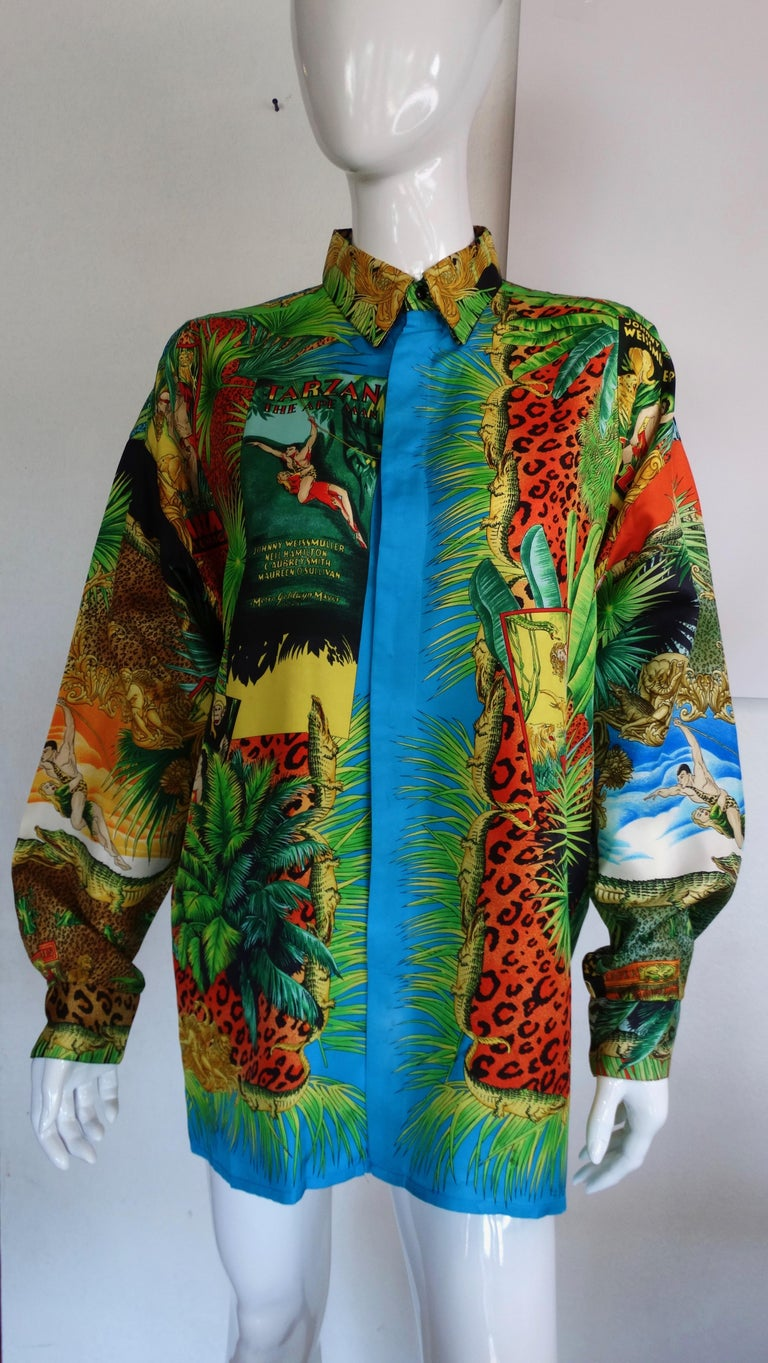 Snag yourself a piece straight from the Versace archives! Circa 1993 from Versace's S/S collection, this tropical Tarzan print features various motifs of Tarzan and Jane, Tarzan memorabilia, multi-colored animal prints, tropical greenery and rich