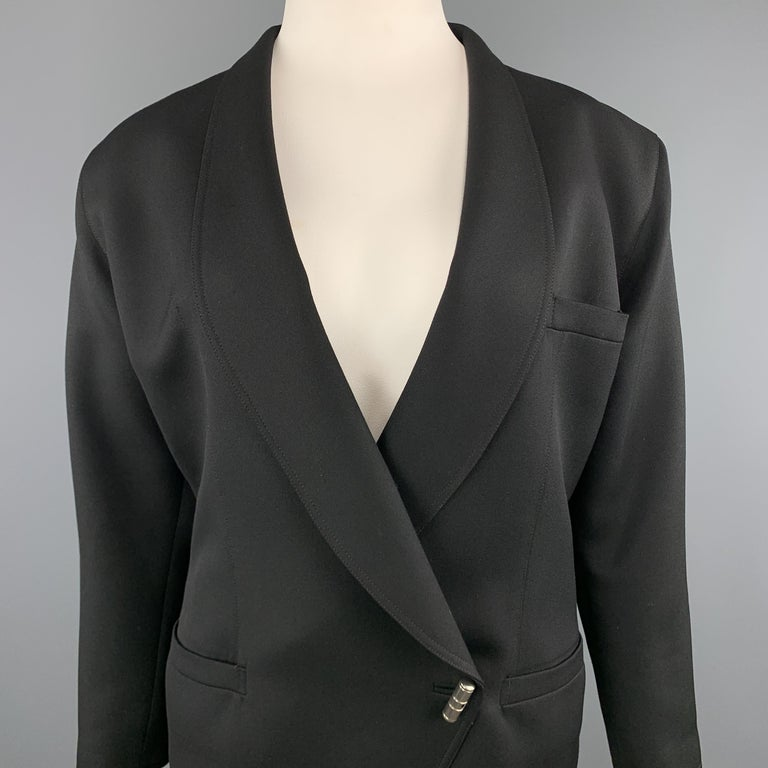 Vintage 1980's GIANNI VERSACE sport coat jacket comes in black wool twill with a shawl collar, double breasted front with single silver tone toggle closure, and toggle closure sleeves. Made in Italy.  Excellent Pre-Owned Condition. Marked: IT