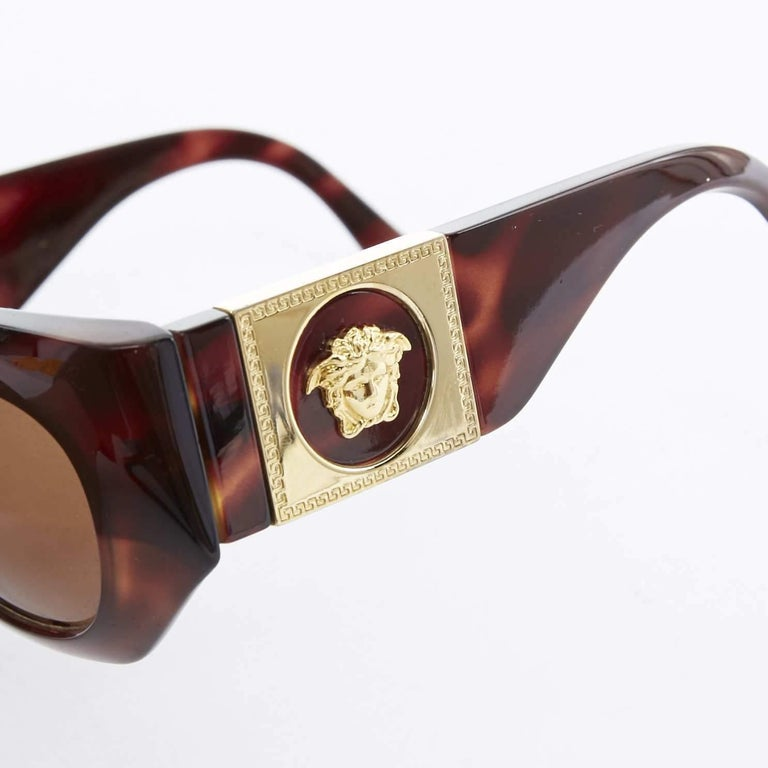 GIANNI VERSACE Vintage brown tortoise angular cateye gold Medusa sunglasses  GIANNI VERSACE Brown tortoise resin frame . Angular frmae . Cateye lens . Thick legs . God Medusa head embellished on side . Made in Italy  CONDITION Excellent- almost