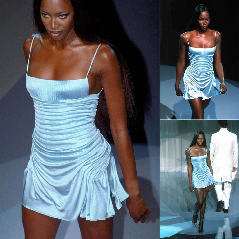 This vintage Gianni Versace dress is in a beautiful lavender silk jersey. A light blue version of this Spring/Summer 2000 dress was worn by Naomi Campbell on the runway. The bodice has a built-in bustier that ends around the top of the hips and the