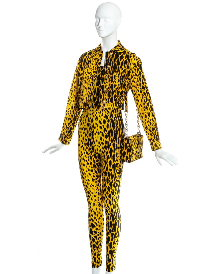 Gianni Versace yellow and black leopard print ensemble, includes lycra bodysuit and leggings, denim jacket and matching flap bag with gold chain.   Spring-Summer 1992