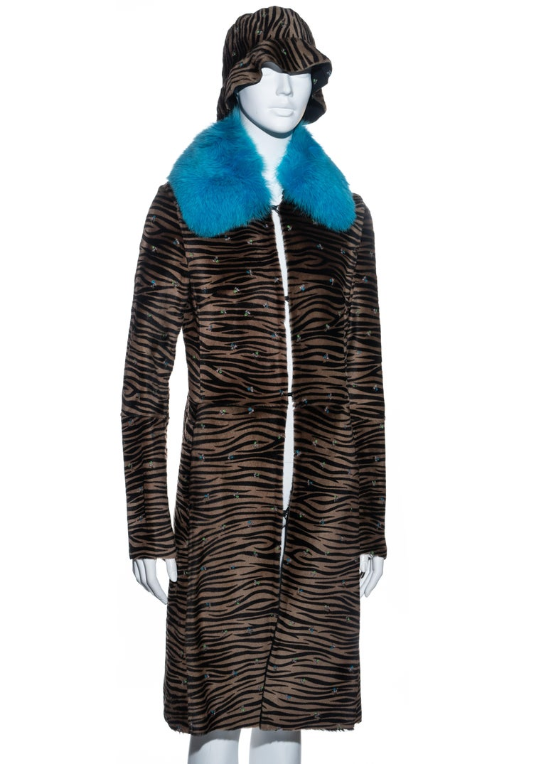 ▪ Gianni Versace pony hair coat and bucket hat set ▪ Zebra print ▪ Small embroidered flowers throughout  ▪ Blue fox fur collar  ▪ Hook fastenings ▪ Two concealed side pockets  ▪ Size Small ▪ Fall-Winter 1999