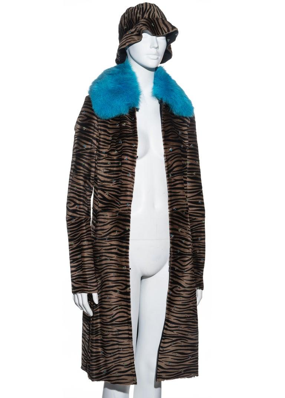 Black Gianni Versace zebra print pony hair coat with fox fur and bucket hat, fw 1999