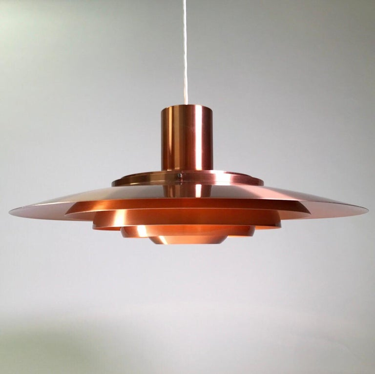 Majestic floating from the ceiling does this elegant and rare P700 copper ceiling light by Jørgen Kastholm and Preben Fabricius for Nordisk Solar Compagni, Denmark 1964.  Finding a P700 copper version in this condition, even here in Denmark, where
