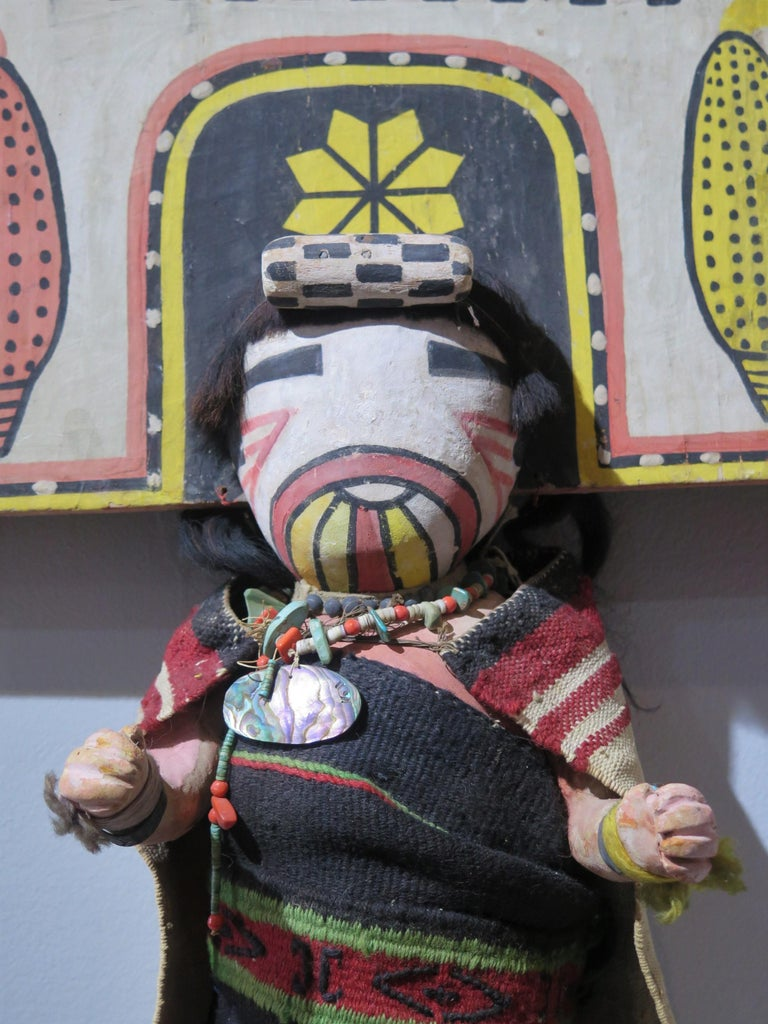 Rare oversized Hopi Palhik Mana Butterfly Katchina of carved and painted wood with cut wood tablita. This must have been a special, perhaps one of a kind piece made for a trading post or gift. The figure is wrapped in wool blanket with necklace of