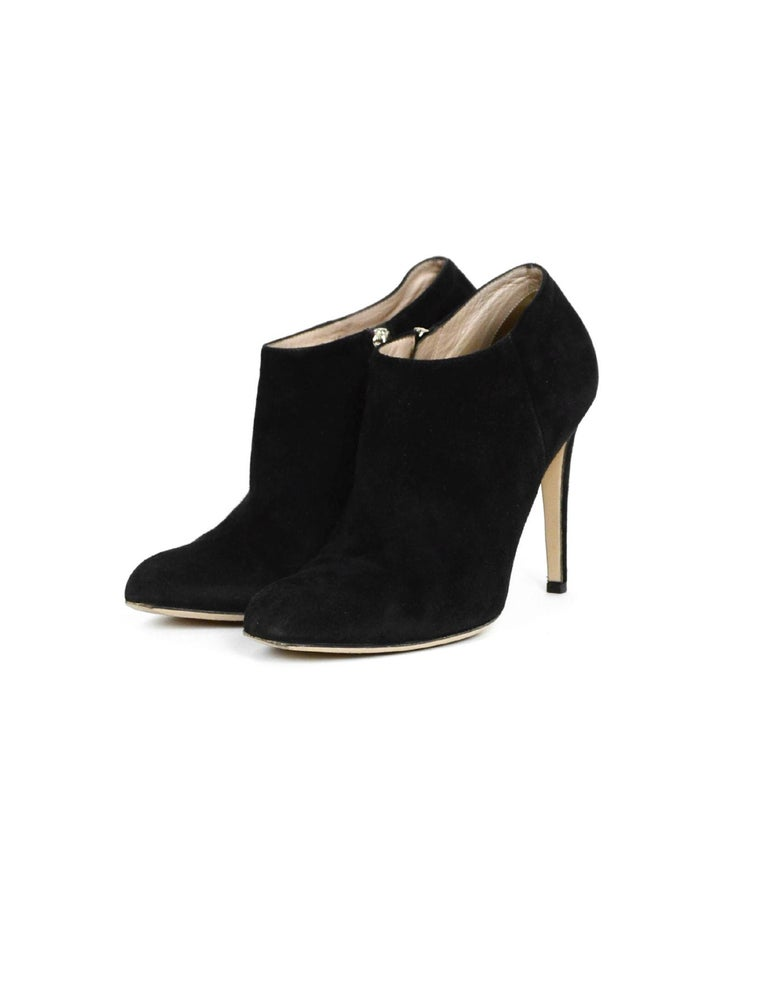 Gianvito Rossi Black Suede Ankle Boot  Made In: Italy Color: Black Hardware: Silvertone Materials: Suede Closure/Opening: Side zipper Overall Condition: Excellent pre-owned condition, light abrasions on heels, wear to soles, color transfer on