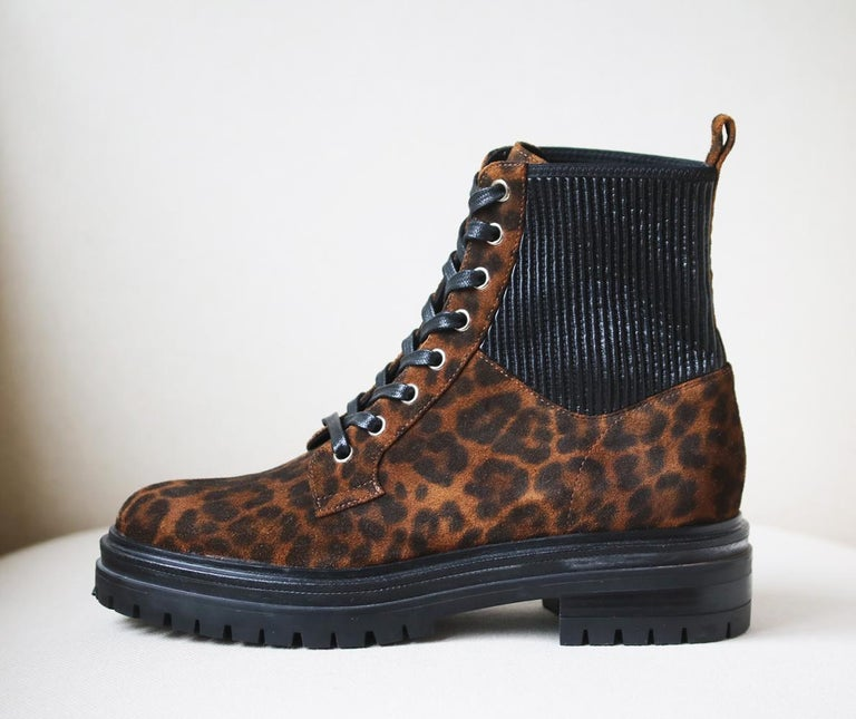 Made in Italy from butter-soft leopard-print suede, Gianvito Rossi's 'Martis' pair is set on chunky gripped rubber soles for traction and has elasticated ribbed panels at the sides that make them easy to pull on.  Heel measures approximately 40mm/