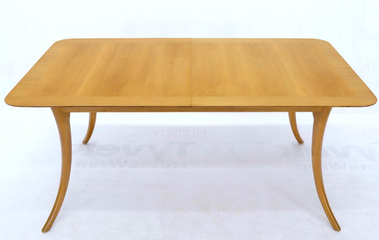 Mid-Century Modern light walnut dining table designed by Robsjohn Gibbing for Widdicomb. All in very clean original condition with 2 x 18
