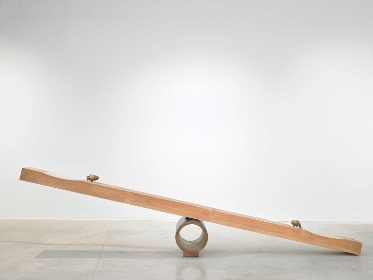Giddy-up see saw by Vivian Carbonell of Carbonell design, a sculpture-trained furniture designer, handcrafted a functioning seesaw, the highlight of ten pieces on view. A chunky slab of Douglas fir timber balances on a dark blue metal pivot and is