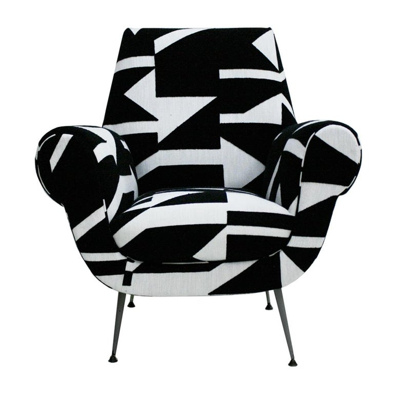 Pair of comfortable armchairs designed by Gigi Radice and produced in Italy in 1950. Structure made of solid wood standing on grey metal tapered legs and black colored metal feet. Linen upholstery with geometric embroidery from the