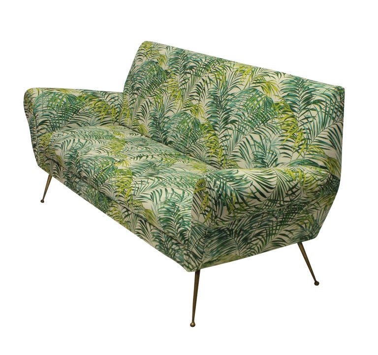 An Italian three seat sofa by Gigi Radice for Minotti, newly upholstered in a good quality palm print cotton linen.