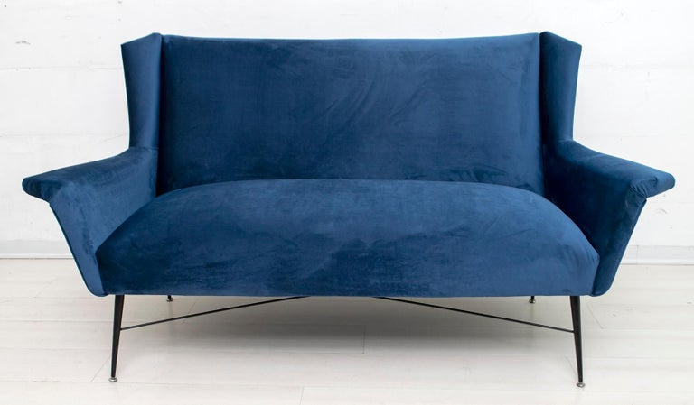 Sofa designed by Gigi Radice for Minotti. Made with solid wood structure and blue velvet upholstery and black lacquered metal legs. The upholstery has been redone.