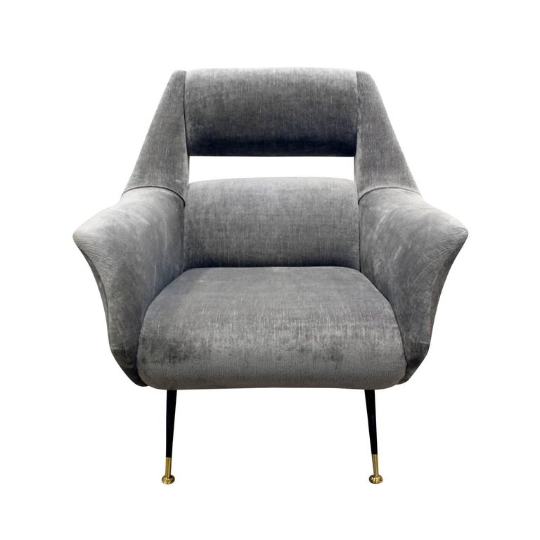 Pair of sculptural lounge chairs with open backs and brass sabots by Gigi Radice for Minotti, Italy, 1950s. Newly upholstered in a grey velvet by Lobel Modern.