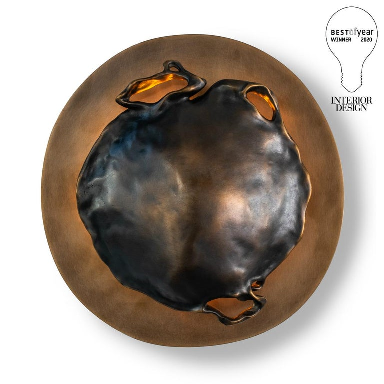 Winner of Interior Design Magazine's 2020 BEST OF YEAR award - the Gil Melott Bespoke Luz SC form 37 Bronze Sconce serves not just as a light fixture, but as an anthropomorphic piece of sculpture adorning the wall. Its delicate form belies its