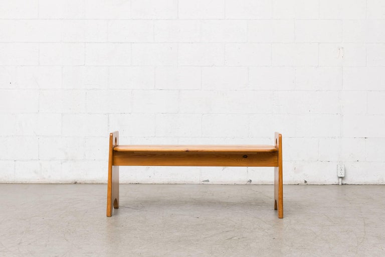 Charlotte Perriand inspired midcentury pine bench with double round cut-out detail. Lightly refinished.