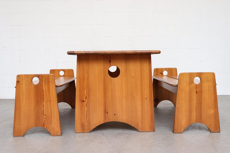 Lovely Gilbert Marklund pine dining table and 2 bench set. Organically carved and jointed. Set consists of one table and two benches. In good original condition with some signs of wear consistent with their age and use. Benches measure: 49 x 16.25 x