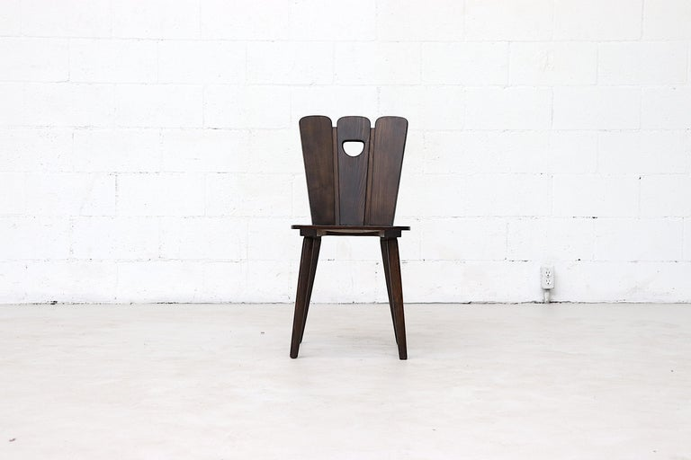 Brutalist style fan topped solid wood dining chairs with 1/2 moon cut-out detail. Lightly refinished in otherwise original condition with some signs of wear consistent with age and use. Priced individually. Color may vary slightly from photo.