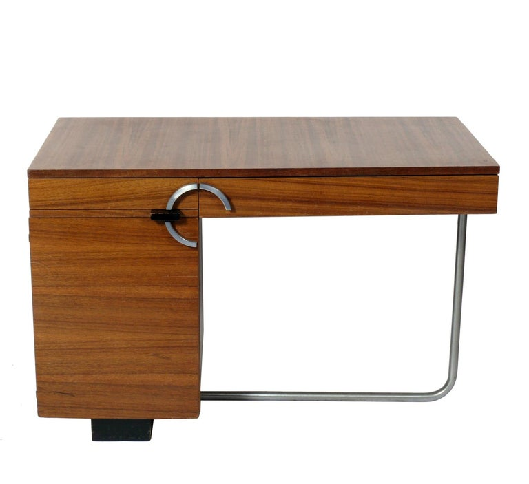 Streamlined Art Deco Desk, designed by Gilbert Rohde for Herman Miller, circa 1930s. It is executed in beautifully grained paldao wood. Please see our other 1stdibs listings for other Rohde Paldao Group pieces to complete your home office. This desk