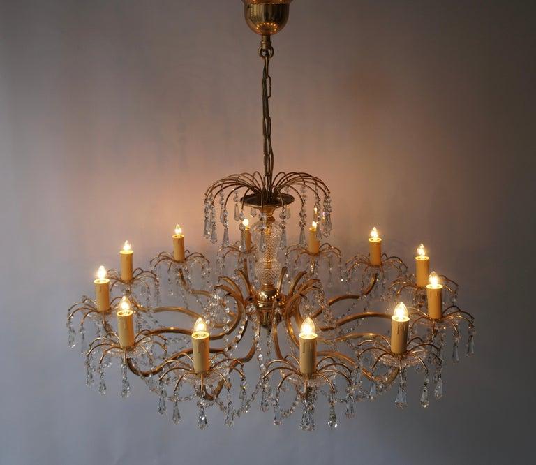 Hollywood Regency Gilded Brass Crystal Chandelier For Sale