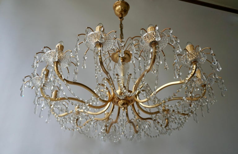 20th Century Gilded Brass Crystal Chandelier For Sale