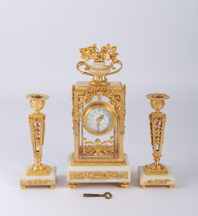 Small Napoleon III style bronze and white marble mantel trim,