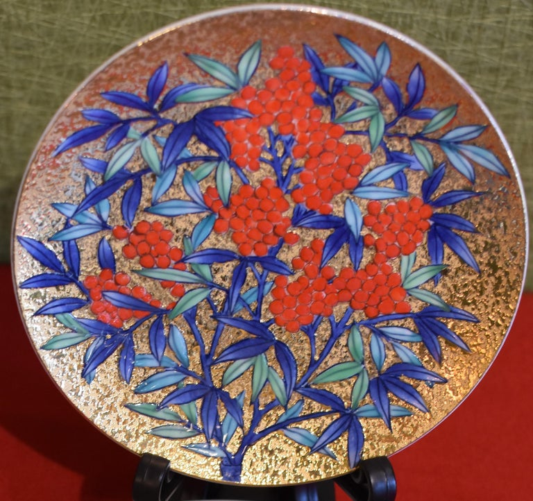 Japanese contemporary Imari gilded porcelain cup and saucer, hand-painted on an attractive gilded body, the work of highly respected award-winning master porcelain artist from the Imari-Arita region of Japan who is admired for his expert use of gold