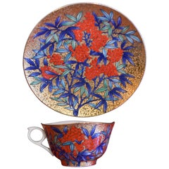 Gilded Japanese red Blue Porcelain Cup and Saucer by Master Artist